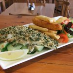 Herb & citrus crusted fish fillets served with chips & salad