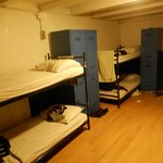 8-beds room with big lockers and a considerable room space