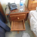 sub standard bedsite table with broken drawers.