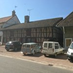 Handy parking opposite in front of typical old Bresse house
