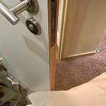 Toilet door abut the bed