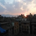 sunset over the rooftops from roof terrace