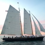 Another sailboat out on the water for a sunset sail