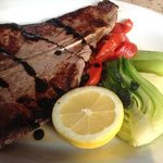 Grilled T-bone Steak with balsamic reduction drizzle.