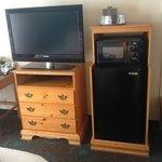 tv with microwave & fridge