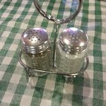 Clean salt and pepper shakers on the tables