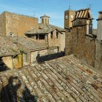 The view of neighbouring roofs and the landmark Torre del Moro from our apartment terrazzo