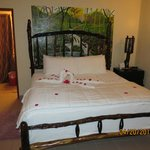 Cute - flowers strewn on the bed