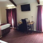 Room and single bed in the Executive Room