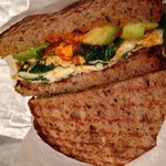 Healthy sandwich: egg white, spinach, avocado on wheat with Sriracha hot sauce