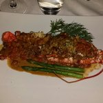 Beautifully prepared local lobster - baked whole stuffed with herbs and sources of asparagus and
