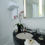 Spacious executive bathroom with a complete array of bath products