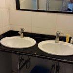 Sink beside the toilet