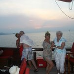 Grandparents, mum and auntie dancing on the deck as the sun sets
