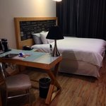 My cute hotel room with wooden floorboards