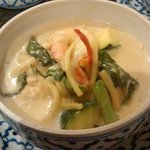 Thai green curry with black tiger prawns