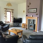 Guest lounge with TV, DVD player, log stove & sea views