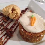 Stacked carrot cake with candied pecans, caramel drizzle and pumpkin ice cream