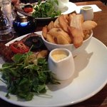 10 oz Rib Eye, Chips, Watercress Salad with Blue Cheese Sauce. Steak cooked to perfection. Cut l