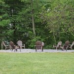 The outdoor fire pit is a gathering place to relax and enjoy some pleasant conversation under th