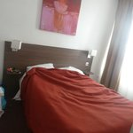 dirty linen and unmade bed or arrival