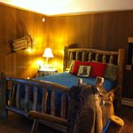 """""""Ski Hill"""" room - Queen log bed & full kitchenette with granite countertop"""