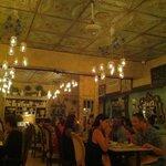 Whimsical, intimate romantic setting- tin tile ceiling, glass hanging fruit jar lighting.