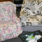 Covered dirty chairs with old bedspreads