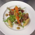 Ham hock, pease pudding, picked carrots and pea purée