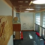 Great Hall with Tile Mural, Wooden Snoopy Mural and Wrapped Dog House