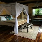 The beautiful bedroom, leading out to the private deck and pool
