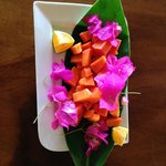 Papaya, presented for breakfast with love and flowers