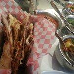 Garlic naan, butter chicken, beef masala, chana masala and saag paneer