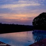 The sunset by the pool