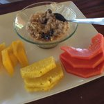Breakfast of fruit and raw oatmeal, oh so delicious