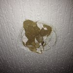 Hole in the wall behind the entrance door room 120