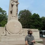 Florent explaining the monument to the pigeons
