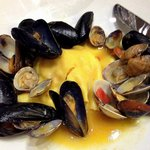 maxi shrimp raviolo with mussels and clams