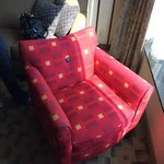 Hip sitting chair in front of BIG picture window