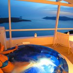 ANEMOS outdoor jetted tub with sea volcano and sunset view