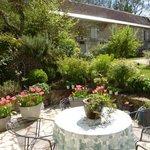 Springtime flowers grace the front patio.