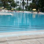 outdoor pool with plenty sunloungers