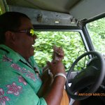 "Our driver/guide playing the ukelele while ""in the ruts"""