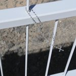 rosary attached to bridge