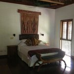 Bed in our sea view room - shutters close at night