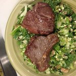 Lamb chops on top of Greek chopped Salad