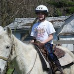 My daughter is thrilled to be going on her very first horse ride.