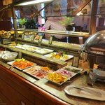 Meats and cheeses on the breakfast buffet