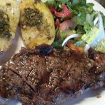 Ribeye steak, salad , grilled potato.