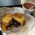 Burnt ends sandwich on garlic toast with cheddar cheese. It's awesome!
